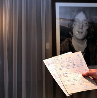 A pair of John Lennon's detention sheets will be auctioned online