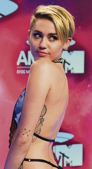 """Miley Cyrus wants fans to see her """"different world"""" and she hopes they will appreciate her vision."""