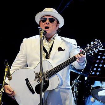 Van Morrison's band is being paid to perform at a concert where he will be awarded the Freedom of Belfast