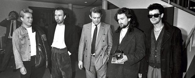 U2 with manager Paul McGuinness in 1986.