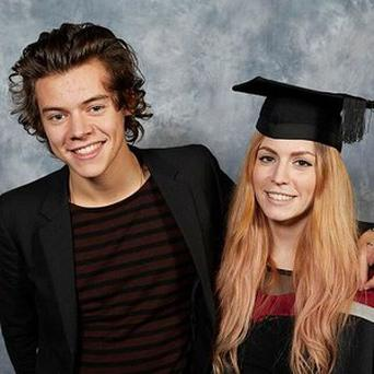 One Direction's Harry Styles with his sister Gemma Styles in her graduation photo at Sheffield Hallam University