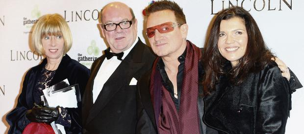 Paul McGuinness with his wife Kathy Gilfillan, Bono and Ali Hewson.