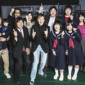 Sir Paul McCartney with victims of the Fukushima nuclear disaster who he invited to a concert