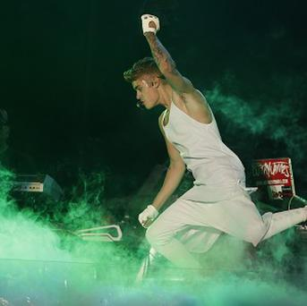 Canadian pop star Justin Bieber performs during his Believe world tour (AP)