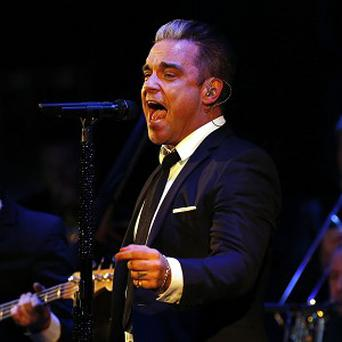 Robbie Williams performs an exclusive gig for Heart radio at Under the Bridge in London
