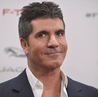 Simon Cowell announced that the profits from the latest X Factor winner's single will go to charity