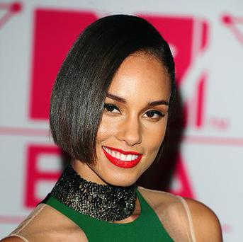 Alicia Keys visited evacuees who had fled from Typhoon Haiyan