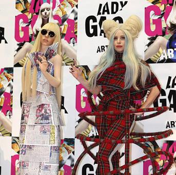 Lady Gaga poses with her life-sized doll in Tokyo