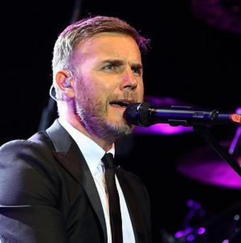 Gary Barlow has said that Take That is his main job