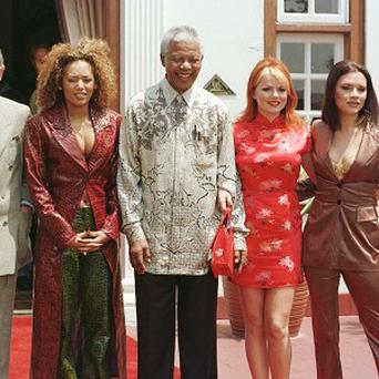 The Spice Girls pose with the Prince of Wales and Nelson Mandela in 1997