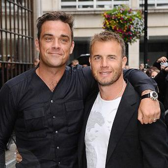 Robbie Williams has admitted he wants to have slightly better album sales than Gary Barlow
