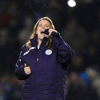 X Factor winner Sam Bailey performs on the pitch at half-time