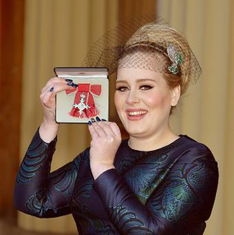 Adele shows off her MBE for services to music