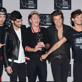 One Direction's Midnight Memories has been crowned the UK's top-selling album of 2013