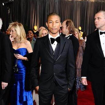 Pharrell Williams is featured on both top two selling singles of 2013