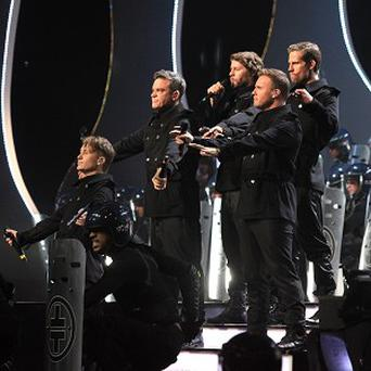 Take That are back in the recording studio, although it's still not clear if Robbie Williams will be joining them