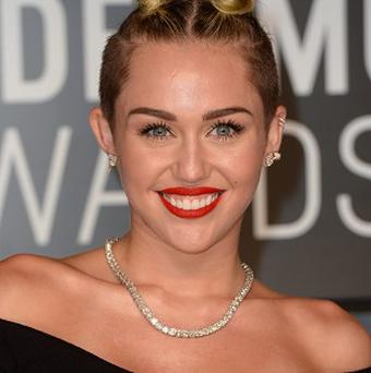 Miley Cyrus will perform at the Clive Davis pre-Grammy bash