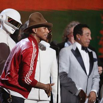 Pharrell Williams, second left, speaks on behalf of Daft Punk at the Grammys (AP)