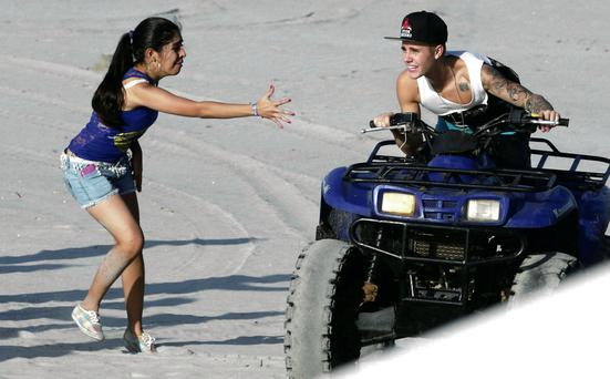 Canadian pop singer Justin Bieber greets a fan at a resort in Punta Chame on the outskirts of Panama City