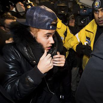 Canadian musician Justin Bieber turns himself in to police in Toronto (AP)