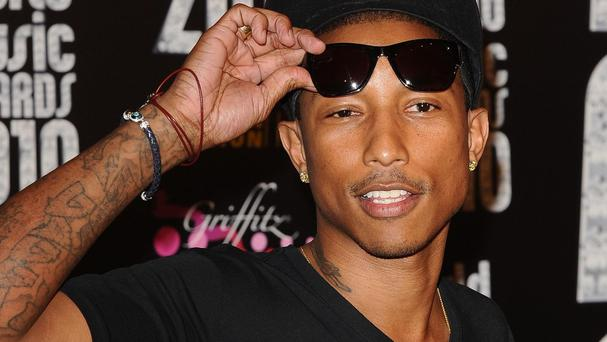 Pharrell's Happy has reached the top of the singles charts for the third time