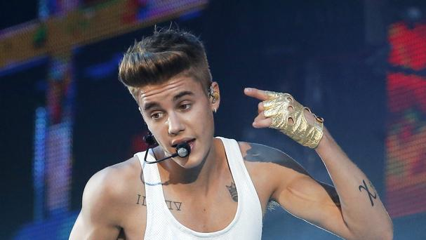 A woman has been arrested for trespassing in Justin Bieber's home