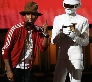 Lucky guy: Pharrell Williams accepts the Grammy for Daft Punk for 'Get Lucky'