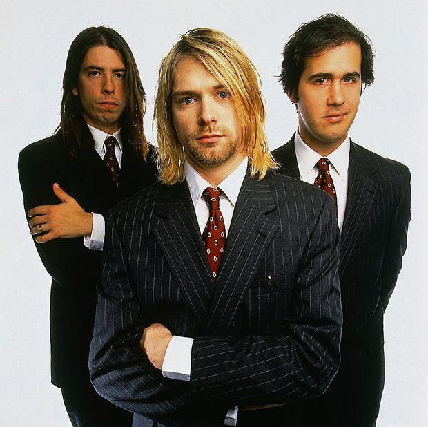 Kurt Cobain with Nirvana members Dave Grohl and Krist Novoselic