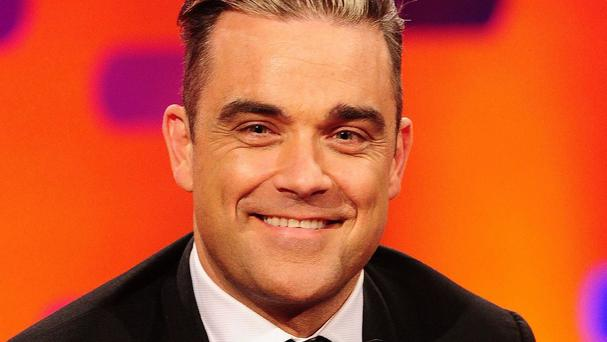 Robbie Williams will duet with his dad on his UK tour