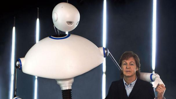 Paul McCartney with Newman the robot, who was created by the team behind War Horse, in his new video