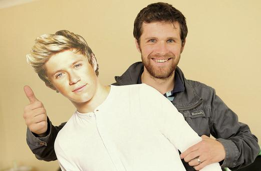 HE AIN'T HEAVY... Greg Horan, brother of One Direction's Niall, with a cutout of his brother. Photo: Gerry Mooney