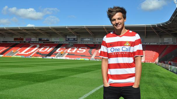 One Direction singer and Doncaster Rovers co-owner Louis Tomlinson has targeted the Premier League for his hometown club.