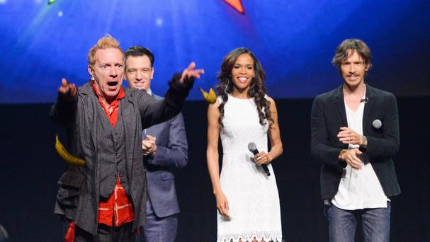 John Lydon throws bananas at the media, watched JC Chasez, Michelle Williams and Brandon Boyd, at a Jesus Christ Superstar press conference (AP)