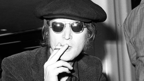 John Lennon was shot dead outside his Manhattan apartment building in December 1980.