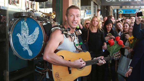 Coldplay's Chris Martin serenades the crowd on the streets of Sydney (Rex)