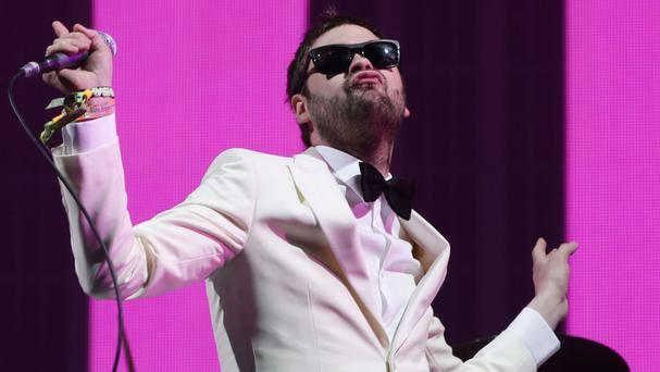 Tom Meighan of Kasabian performing on the Pyramid Stage at the Glastonbury Festival