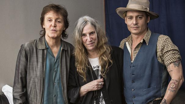 Paul McCartney with Patti Smith and Johnny Depp on the set of McCartney's Early Days music video shoot (MPL Communications/PA)