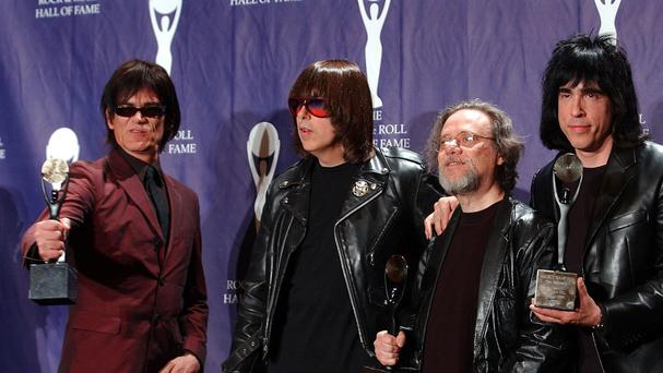 The Ramones, from left to right, Dee Dee, Johnny, Tommy and Marky Ramone after being inducted at the Rock and Roll Hall of Fame. (AP)