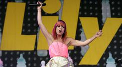 Lily Allen has showed off her toned figure on stage