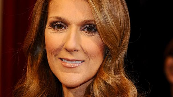 Celine Dion has returned to work a month after husband Rene's death.
