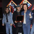 Malcolm Young (far left) with AC/DC