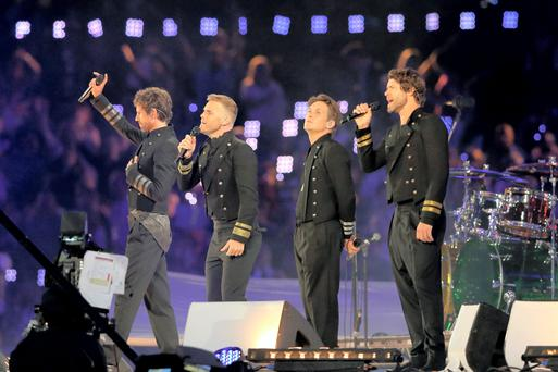 Jason Orange, Gary Barlow, Mark Owen and Howard Donald of Take That perform during the Closing Ceremony on Day 16 of the London 2012 Olympic Games