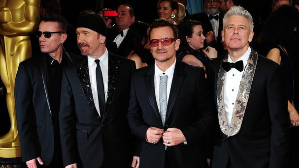 U2 - Bono, The Edge, Adam Clayton and Larry Mullen Jr - will tour in 2015
