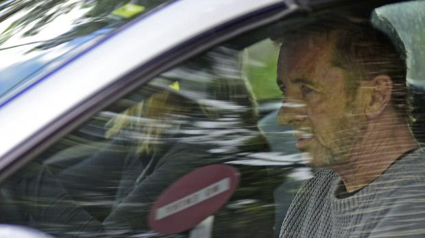 Phil Rudd, drummer for AC/DC, leaves a court in New Zealand (AP/Bay Of Plenty Times via The New Zealand Herald)