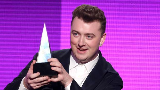 Sam Smith with his award for favourite pop/rock male artist