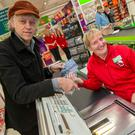 Bob Geldof with checkout worker Ali Hallam at the Asda Trafford Park store in Manchester for the launch of the Band Aid 30 CD 'Do They Know It's Christmas?'