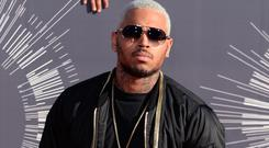 Chris Brown will miss a NYE gig because of a lost passport