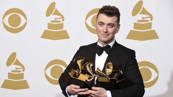 All mine - Sam Smith proudly shows off his four Grammys (AP)