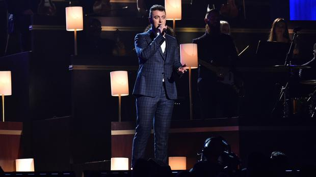 Sam Smith wore three different outfits, including this one as he performed at the Grammys (AP)