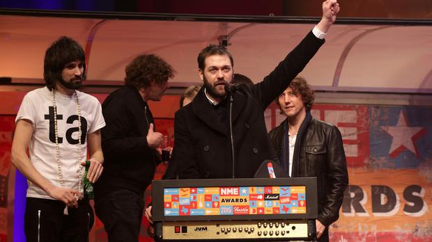 Kasabian made up for their Brits snub by picking up three gongs at the NME Awards.
